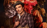 David LaChapelle photographed with one of his works at the Robilant + Voena Gallery, London